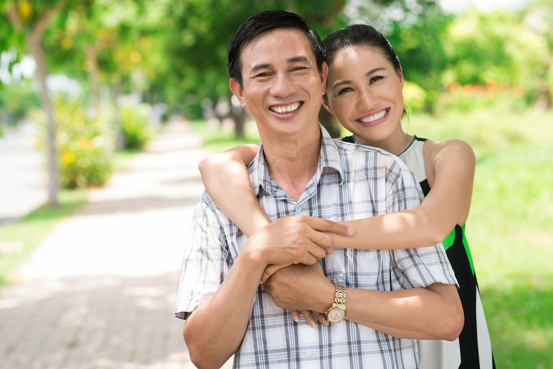 Image of middle-aged Asian couple representing NBS Home Loans clients - best home loans for All Australians