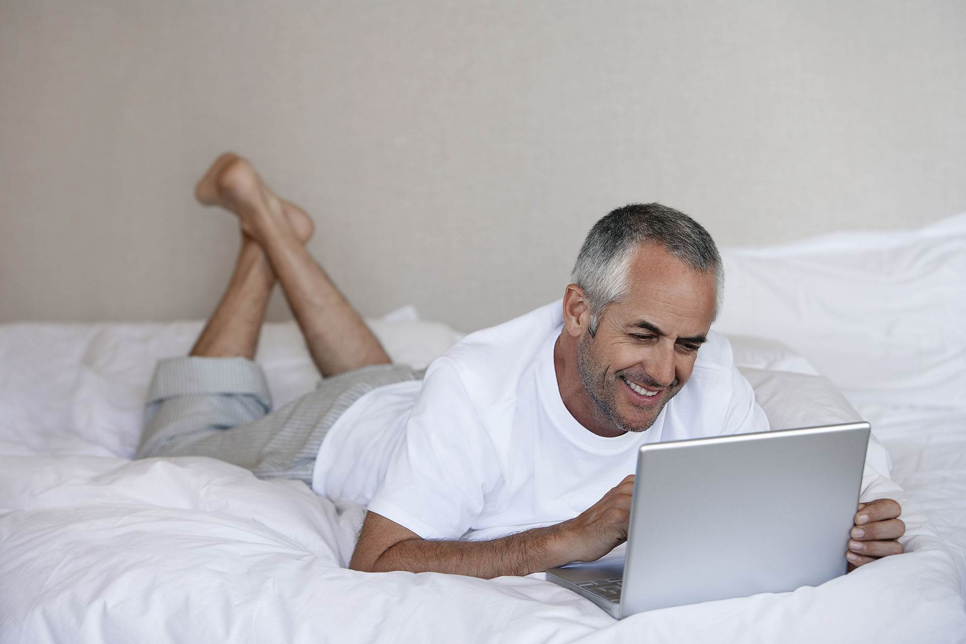 Image of a middle-aged man on his laptop representing NBS Home Loans Business Loans Services