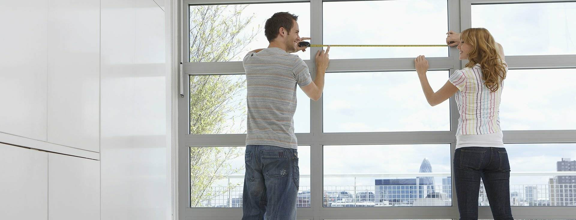 Image of young couple measuring home for a renovation representing NBS Home Loans Best Home Loan Financial Services for All Australians